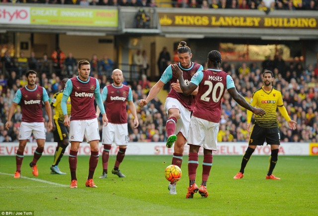 2DF9D1F800000578-0-Andy_Carroll_third_from_right_failed_to_clear_the_ball_which_lea-a-97_1446310085906