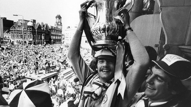 April 1980:  Alan Devonshire lifts the FA Cup over his head at a civic reception in West Ham to celebrate West Ham United's 1-0 victory over Arsenal in the FA Cup final .  (Photo by Evening Standard/Getty Images)